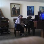 pianist with very happy piano