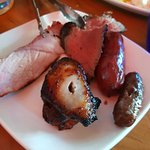 Selection of meats to accompany hot and cold buffet. Sliced from skewer at our table.