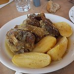 "This dish of goat and potatoes baked in the wood oven was my humble and ""light"" lunch."