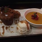 Desert platter with tamarind sticky pudding, banana fritter, coconut crème caramel, vanilla ice