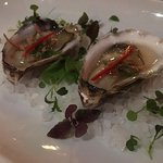 Fresh Sydney rock oysters with a pickled shallot and ginger sweet fish sauce dressing.