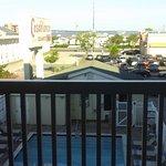 Room 311 balcony overlooks pool and bayside, parking across street.