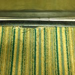 The worn out carpeting in the elevator