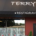 Terry's is behind Village pub off the main street in Charlevoix. Street parking.