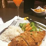 Fandangles pecan crusted chicken, popcorn rice and vegetables with a Peach Martini.