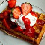 homemade vegan waffle with strawberrys and vegan whipped cream