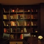 Tastefully decorated shelves in dining/lounge area
