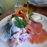 Rollmop herring and smoked salmon with potato and beetroot salad, served with toast.