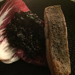 """""""Special"""" dish of crusted baked salmon with squid ink risotto.  Fabulous flavours and very well"""