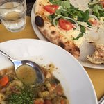 Pizza with salad and minestrone soup.