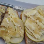 Toasted bread with fig jam, brie, sliced apple and onion relish. Delicious!