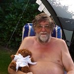Relaxing in the garden with Clover the bear.
