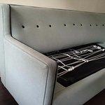 Filthy, broken sofa bed.
