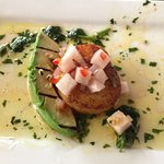 Seared scallop with grilled avocado, jicama and chimichurri sauce.