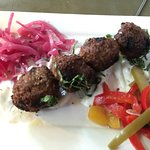 Lamb Kibbeh Spiced meat balls pickled onions, mint yogurt and olive oil