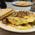 Cody's omelet with bacon, ham, green chile, and cheese. Hashbrowns were crispy but tender
