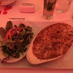 Lasagna with bolognese and bechamel sauce and side salad