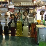 """Soda Jerk Chris and the selection of soda syrups with unique """"corks"""""""