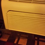 AC falling apart with plastic container to catch water. You can't see how loud it is.