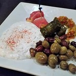 Tapas Mediterranean Plate - tzatziki, stuffed grape leaves, prosciutto wrapped melon, mixed oliv