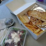 Grilled snapper, small chips and Greek salad