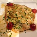 Sea bass (spigola) with a crust of zucchini and breadcrumbs