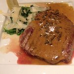 Entrecote with green peppercorn sauce, sautéed spinach and parmesan scales