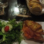 croissant with salmon and salad