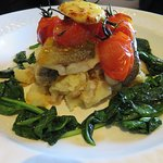 Sea Bass mains with vine tomatoes and spinach at The Castle Inn