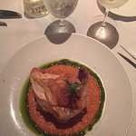 This is my roast chicken stuffed with goat cheese settled in a squash mousse. Delicious