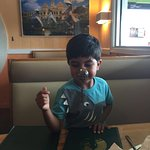 My Grand son having fun, overview of the Restuarant.