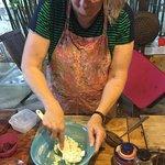 Mixing pandan water into glutinous rice flour