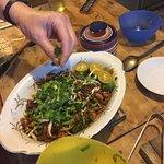 Garnishing Char Kwai Teow