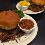 Pork & brisket sandwiches with corn, mac & cheese, green beans, and baked beans.