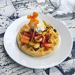 Yep, this is healthy! Gluten free waffles topped with our mix of seasonal fruits and our own coc