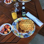 Delicious breakfast waffles, bacon, and fresh fruit. I was full until dinner!
