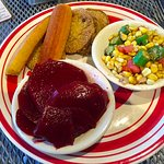 Fried green tomatoes, corn with okra, pickled beets and cornbread.