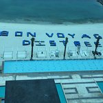 Neat bon voyage message (written with lounging beach chairs) to a group departing the resort .
