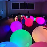 Playing in area with huge lighted color balls.