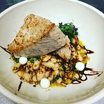 Pan seared Local yellowfin tuna with pumpkin purée , white bean salad,corn,tomato,cilantro,ginge