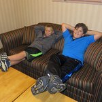 Grandsons Frank and Matt enjoying the sofa bed and TV in the suite.