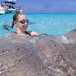I never expected this girl to get in the water with the stingrays ... but she loved it!