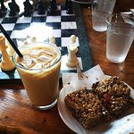 Chilled latte and homemade granola bar.