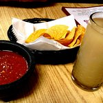 Mild salsa, fresh hot chips and a margarita.