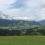 View of Kitzbuhel with Hahnenkamm in background.