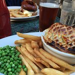 Chicken and vegetable pie with chips and peas. Very English!