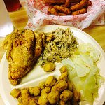 Barbecue and fried chicken plate and basket of hush puppies and corn sticks