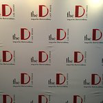 Get your photo taken in front of the D wall before the show.