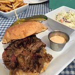Beef brisket sandwich with a nice side of slaw. Get the very good chipotle mayo on the side and