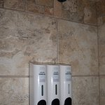 Shampoo, conditioner & body wash dispensers in the shower area were so handy!